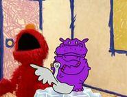 A goose tickles Elmo