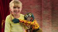Gonzo hugs a girl, telling her he can't leave her