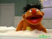 Ernie sings while bathing in the remake version of Singing in the Shower
