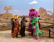 Barney, Baby Bop, BJ and the kids as cowboys and cowgirl in Barney's Adventure Bus