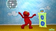 Elmo and Dorothy jam to the Happy Dance