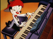 Wakko playing on piano