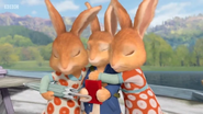 Flopsy and Mopsy hugging Peter