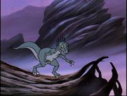 Dromaeosaurus on log