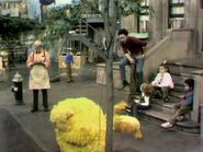 Big Bird sleeping on the sidewalk in episode 181