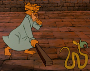 Prince john chases sir hiss in the castle