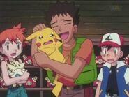 Brock Petting Pikachu