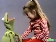 Joey touches Kermit's tummy and it tickles him