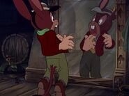 Lampwick seeing himself in the mirror