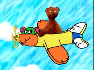 Baby Bear rides on Hero Guy as an airplane