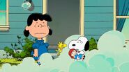 Lucy watches Snoopy and Woodstock are taking care of a doll