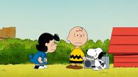 Snoopy pulls Charlie Brown away for exercise