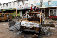 Children-play-on-top-of-a-vehicle-destroyed-during-post-election-violence-in-Kibera-Nairobi.-Photo-The-StarKenya