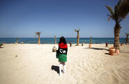 Girl wrapped in Libyan flag