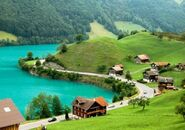 938142-view-from-above-of-a-village-by-lake-brienz-during-springtime-near-meiringen-switzerland