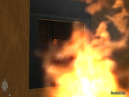 Max baker and whore face in fire at left