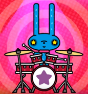 Momo playing the drums