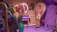 Barbie tying up Ken