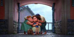 Luca-Hugging-His-Family.jpg