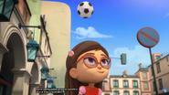 Amaya bounces the soccer ball on her head.