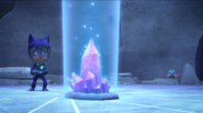 The crystal glows in a blue color
