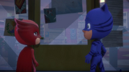 Owlette and Catboy looking at each other