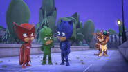 The PJ Masks talk while Armadylan lifts PJ Robot