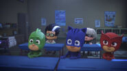 PJ babies and baby villains sitting in desks
