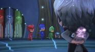 Mothzuki hides behind Luna Girl's back