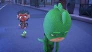 Gekko slowly walking away while Lionel looks at him