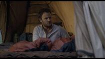 Malcolm wakes Ellie.jpg