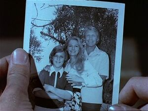 Virdon carries a photo of his family