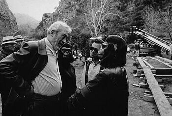 John Huston on set with Roddy McDowall and Natalie Trundy