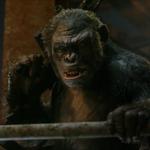Koba snarls at Caesar while holding a gun.png