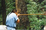 1024px-Blowgun demonstration in Oconaluftee Indian Village, Cherokee, North Carolina.jpg