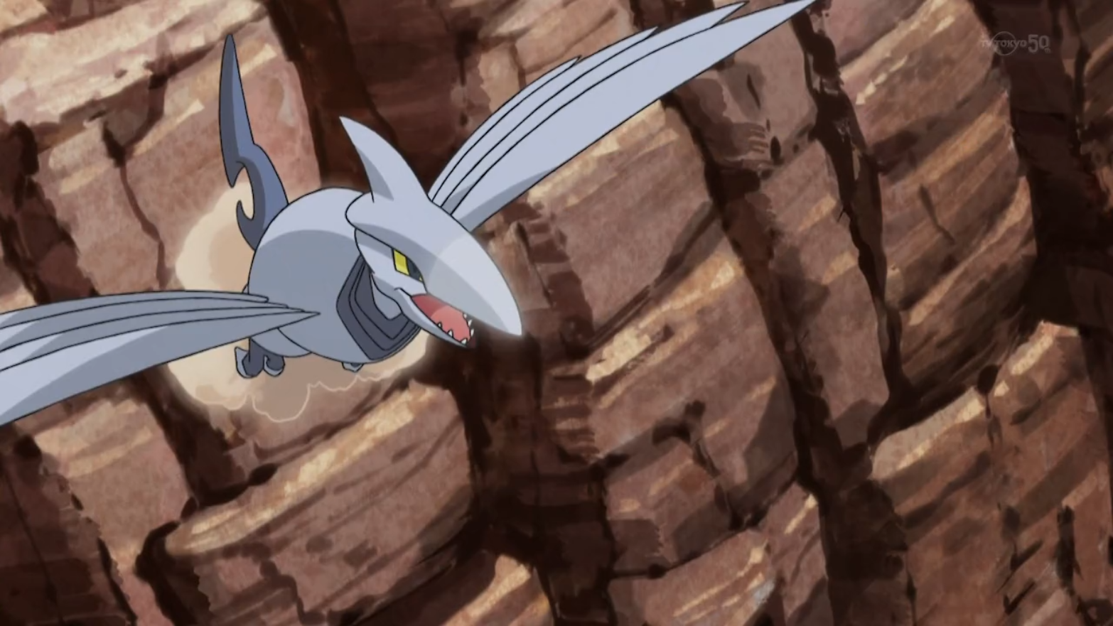 The Sky Trainer used his Skarmory in a sky battle against Moria and her Talonflame. Skarmory used its Fury Attack on Talonflame but the attack was dodged. Skarmory was eventually knocked out by Talonflame with the use of Fire Blast.