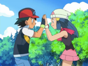 Ash and Dawn high-fiving