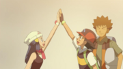 Dawn and Ash high-fiving
