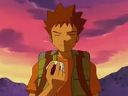 Brock eating a rice ball