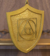 Gold Mundane Defense Charm.jpg