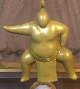Gold Sumo Charm.jpg