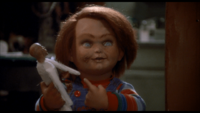 Child's Play Chucky holding a voodoo doll