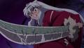 InuYasha wielding the Dragon-Scaled Tessaiga