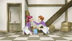 Rin putting dust on Nozomi