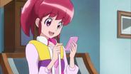 Megumi tratando de avisarle a su amdre por el cure line