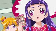 Riko con la tarjeta de la escuela magica
