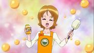 Yuko les ensela a las chicas como ahcer los dulces de miel