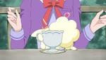 YPC514 Coco hides behind teacup