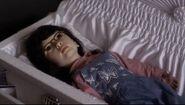 Mona doll in casket