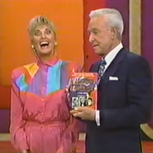 Bob Holds Janice's Book.png